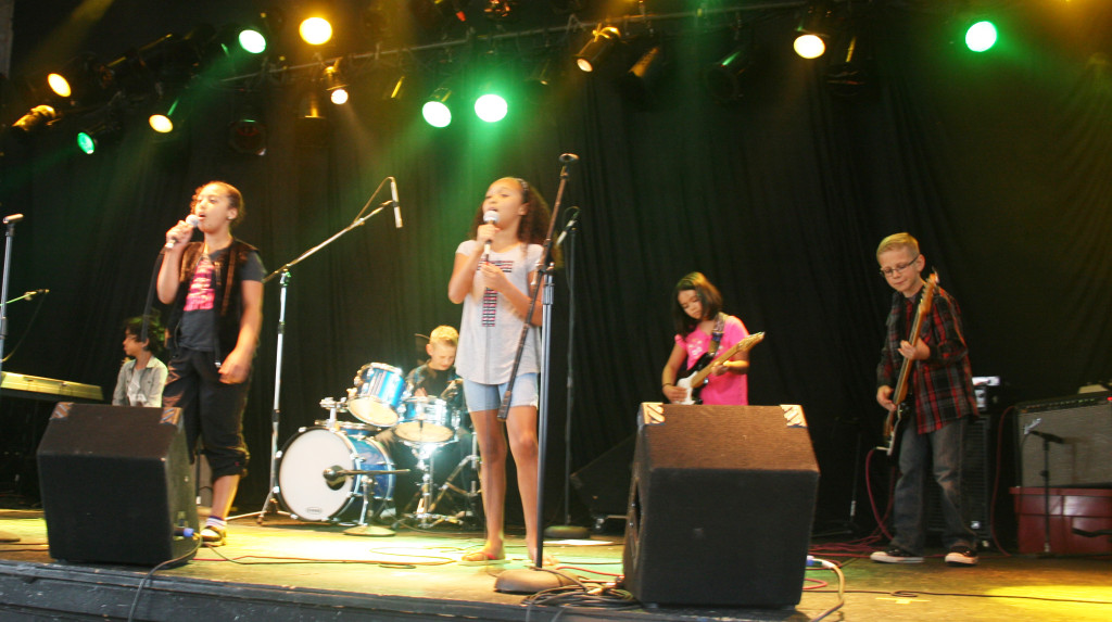 image of students performing live on various musical instruments as part of the Advanced Young Rockers Program