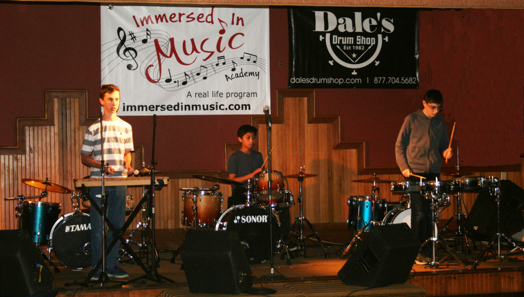 image of 3 students performing on percussion instruments as part of the Drum Ensemble Program